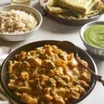 Vegan Potato Curry with Cauliflower and Green Beans with chutney and chickpea crepes